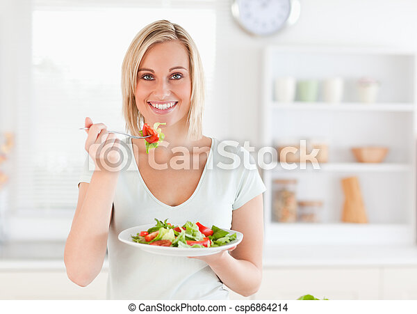 Close up of a gorgeous woman eating salad - csp6864214