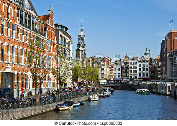 Channels in Amsterdam. Typical Amsterdam architecture. Floating Flower Market. Urban space in the spring.  - csp6865883
