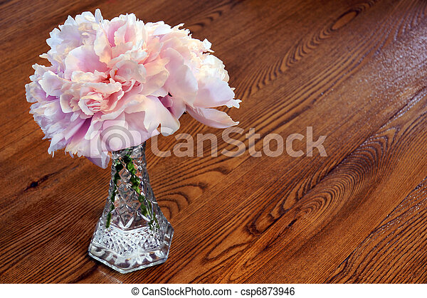 Peony flowers on wooden table - csp6873946