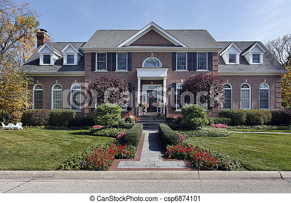 Luxury brick home with columns - csp6874101