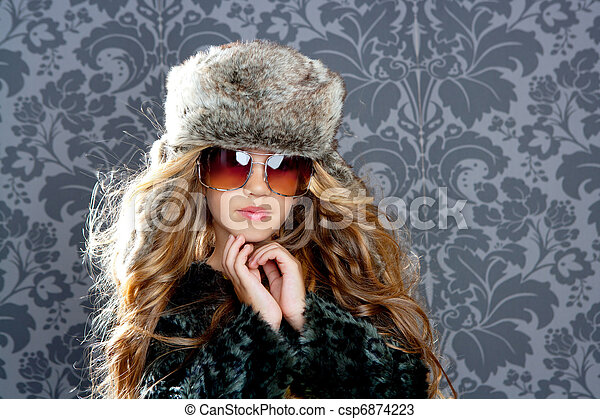 children fashion blond girl with fur winter coat and hat - csp6874223