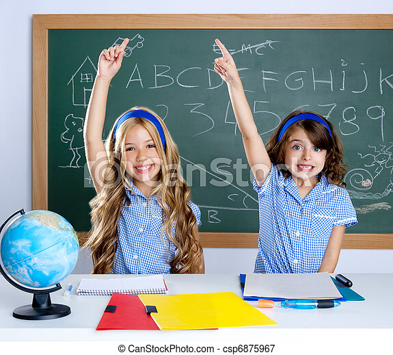 clever students in classroom raising hand - csp6875967