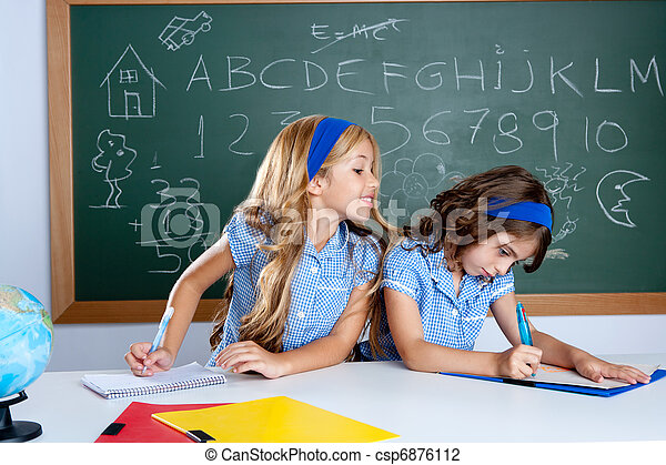 classroom with two kids students cheating on test - csp6876112
