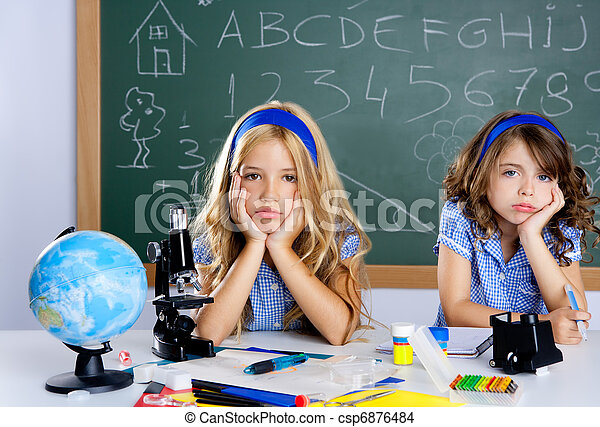 Bored student kids at school classroom in desk - csp6876484