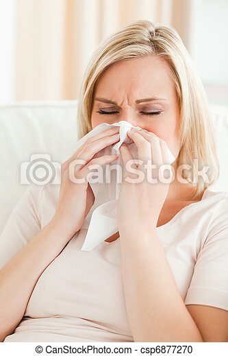 Portrait of an ill woman blowing her nose - csp6877270