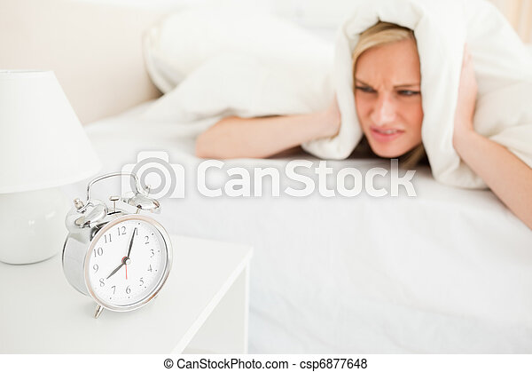 Displeased cute woman waking up - csp6877648