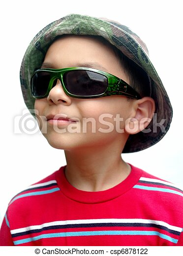five year old boy wearing a camouflage cap and green sunglasses ...