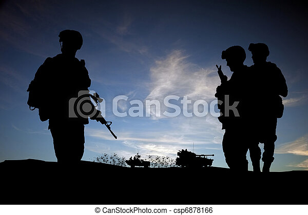 Modern day soldiers in Middle East silhouette against sunset sky with vehicles in background - csp6878166