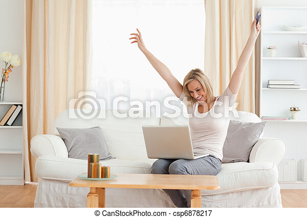 Cheerful woman shopping online - csp6878217