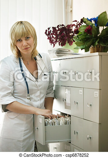 medical intern searching for patient's records  - csp6878252