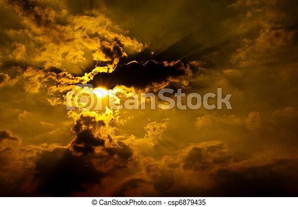 Summer orange evening sky with sun rays & clouds