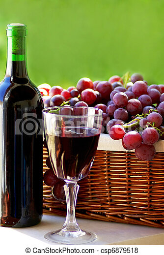 bottle of red wine, a glass of wine and  grapes - csp6879518