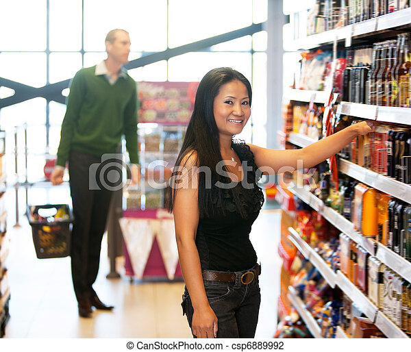 Portrait of a woman in grocery store - csp6889992