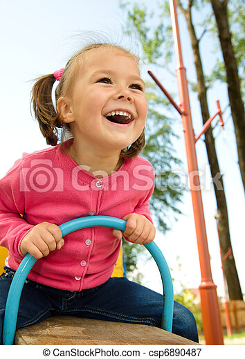 Cute little girl is swinging on see-saw - csp6890487