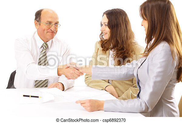 Business people shaking hands, finishing up a meeting  - csp6892370