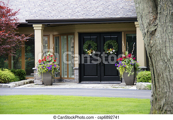Gorgeous home entrance with pretty pots of flowers.