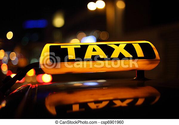 Yellow taxi sign at night - csp6901960