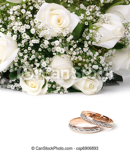 wedding rings and roses bouquet - csp6906893