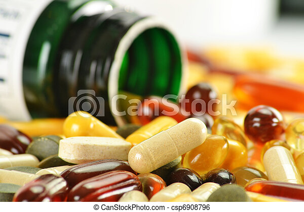 Composition with dietary supplement capsules and containers - csp6908796
