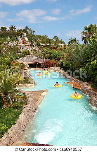 TENERIFE ISLAND, SPAIN - MAY 22: The tourists enjoying water attractions in Siam waterpark on May 22, 2011 in Tenerife, Spain. The Siam is the largest water theme park in Europe. - csp6910557