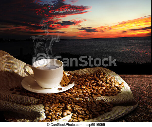 Steaming cup of coffee - csp6916059