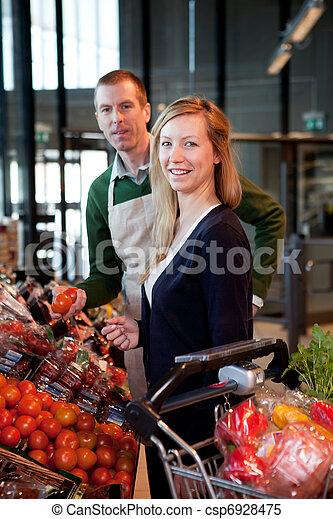 Supermarket Woman and Clerk - csp6928475