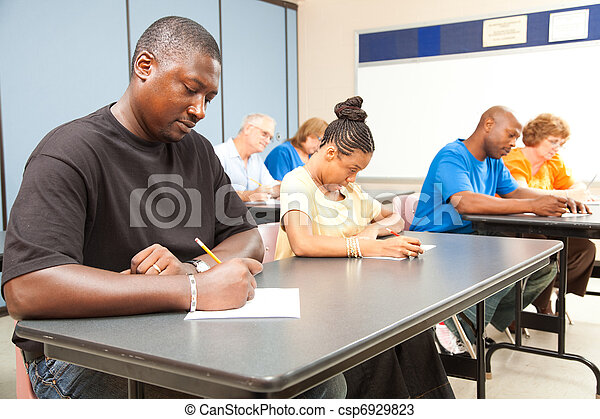 Adult Students Taking Test - csp6929823