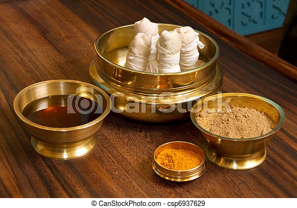 herbs powder and oil in bronze cups - csp6937629