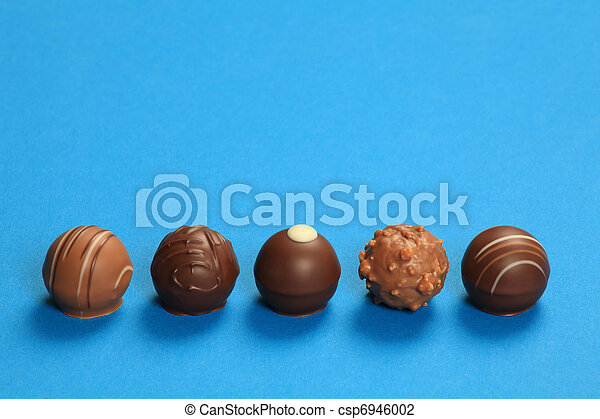 Five chocolate truffles in a row - csp6946002