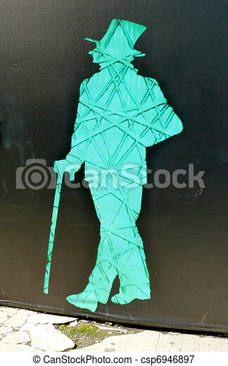man with top hat and cane silhoette - csp6946897