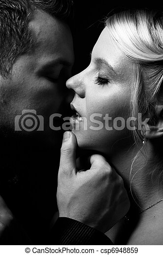 young couple kissing - csp6948859
