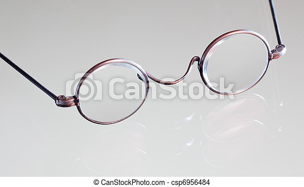 Antique reading glasses isolated - csp6956484