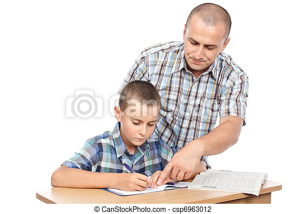 Father verifying son's homework - csp6963012