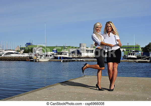 Two girls with the documents standing on the pier - csp6966008