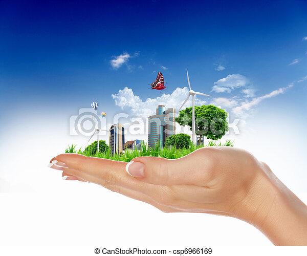 human hand holding a green city - csp6966169