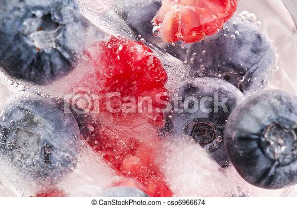 Raspberry and blackberry frozen in ice sticks - csp6966674