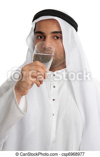 Arab man drinking pure fresh water - csp6968977
