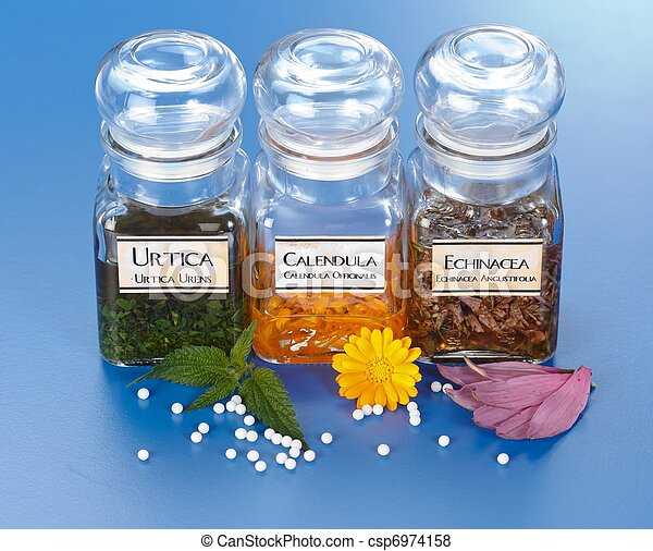 Various plant extract in bottles and homeopathic medication - csp6974158