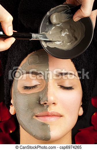 applying facial mask - csp6974265