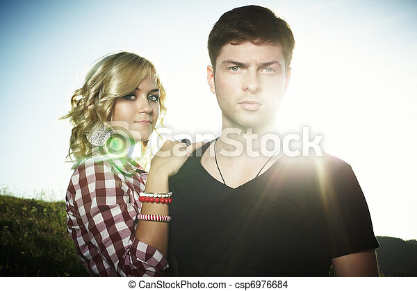 Portrait of love couple embracing outdoor in park - csp6976684