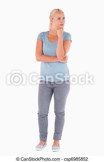 Cute pensive woman posing - csp6985852