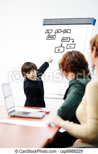 Genius kid on business presentation speaking to adults and giving them a lecture - csp6988229