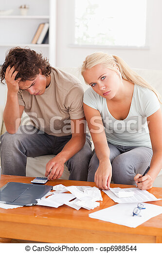 Despaired worn out couple calculating their expenses - csp6988544