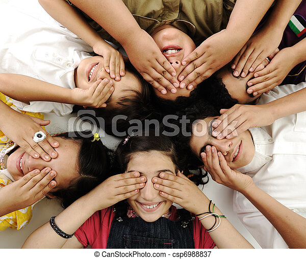 happy children group  lying and closing eyes by hands - csp6988837