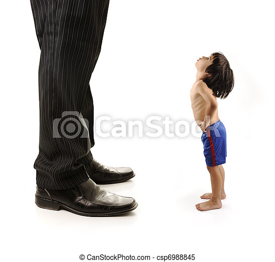 Little small child  is looking at the giant legs of  businessman adult - csp6988845