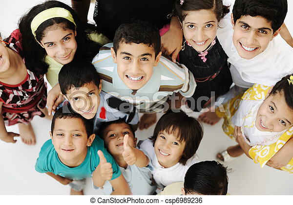 Large group of happy children, different ages and races, crowd - csp6989236