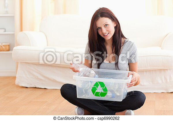 Cute woman with a recycling box - csp6990262