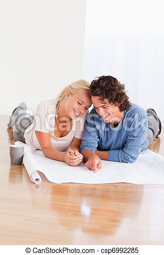 Portrait of a young couple organizing their new home - csp6992285