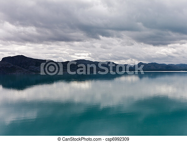 view of the mountains and fjords, overcast - csp6992309