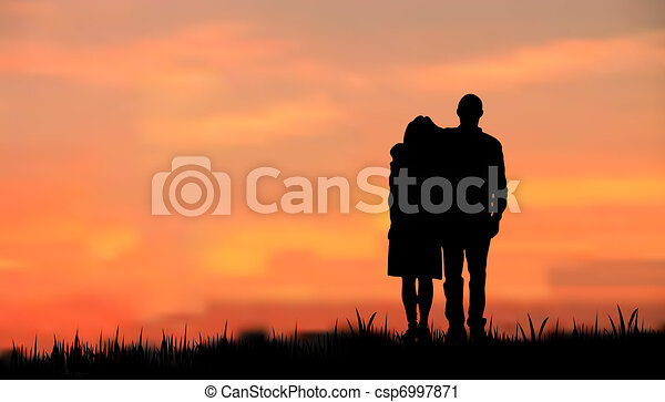 couples as a silhouette against sunset/sunrise - csp6997871